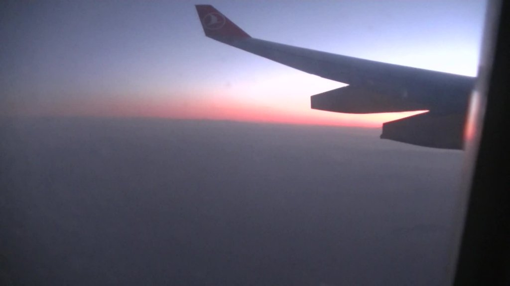 Sunrise while the flight from Istanbul nach Kathmandu - Highslide JS